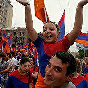 """Young people celebrate the national """"Flag Day"""" holiday in Yerevan, the capital of Armenia."""
