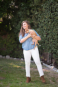 Natalie laughing in her backyard in Pasadena with her dog, February 2016