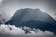 Black & White image of Imbabura Volcano in the clouds.