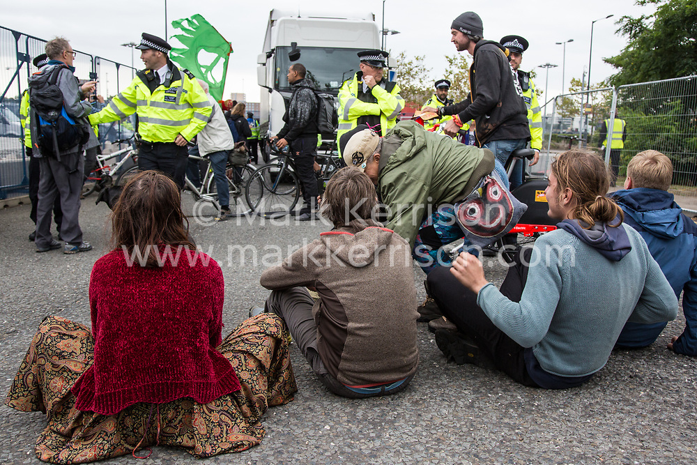 London, UK. 6 September, 2019. Climate activists block one of the two main access roads to ExCel London during Stop The Arms Fair protests on the fifth day of a week-long carnival of resistance against DSEI, the world's largest arms fair. The fifth day of protests was themed as Stop The Arms Fair: Stop Climate Change in order to highlight links between the fossil fuel and arms industries.