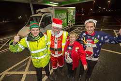 Andy Law, the Dundee Asda delivery driver that has become a hit with customers after dressing up as Santa. Pic with colleagues Cameron Watt, Dawn McCann and Craig Fisher.