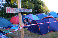 Mandatory Credit: Photo by STEVE MEDDLE / Rex Features<br /> TENTS BEHIND A 'NO CAMPING' SIGN<br /> GLASTONBURY FESTIVAL DAY 2, BRITAIN - 28 JUN 2003<br /> <br /> TENT CAMPER CAMPERS