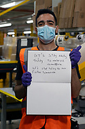 From Morocco via Italy,  Worked at Amazon for 7 mths. Holding paper showing two impacts of  this COVID lockdown.