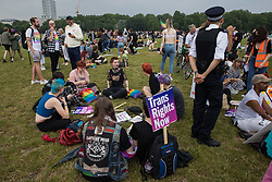 London, UK. 24th July, 2021. Thousands of LGBTI+ protesters hold a Queer Picnic in Hyde Park following the first-ever Reclaim Pride march. Reclaim Pride replaced the traditional Pride in London march, which many feel has become too commercial and strayed from its roots in protest, and was billed as a People's Pride march for LGBTI+ liberation.