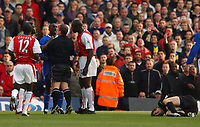 Jens Lehmann (Arsenal) lies injured as referee Mr Paul Durkin (Chelsea) Arsenal v Chelsea, Highbury, 18/10/2003, Premiership Football. Credit : Colorsport / Robin Hume. Digital File Only.