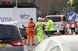 © Licensed to London News Pictures. 26/11/2015. London, UK. Construction workers who were working in the tunnel prevented from working by the demonstration. A group of Airport expansion activists cause traffic chaos by blocking off the inbound tunnel of Heathrow airport in London to protest against airport expansion.  Photo credit: Peter Macdiarmid/LNP