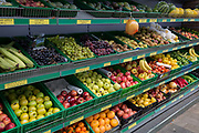 A diagonal view of an exterior of a local corner shop stocking loose nutritious fruit and veg from the shelves including oranges, bananas, apples and grapes, outside a shop in Bromley town centre where local businesses offer fresher and cheaper foodstuffs than the larger supermarkets, on 3rd February 2020, in London, England.