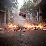 Protesters throw cardboard boxes into a burning barricade in Nikis Street near  Syntagma  (Constitution) square, June 29, 2011