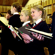 Girls singing at choir practice at Ampleforth College, North Yorkshire, UK. Ampleforth College is a coeducational independent day and boarding school in the village of Ampleforth, North Yorkshire, England. It opened in 1802 as a boys' school, and is run by the Benedictine monks and lay staff of Ampleforth Abbey.