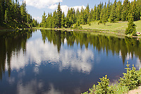 Cloud reflections in Lake Irene, Rocky Mountain National Park, Colorado.