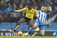 Burton Albion striker Lucas Akins (10) tackled by Brighton & Hove Albion defender Shane Duffy (22) during the EFL Sky Bet Championship match between Brighton and Hove Albion and Burton Albion at the American Express Community Stadium, Brighton and Hove, England on 11 February 2017.