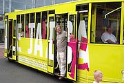 Tour bus at Manufactura entertainment center. Man at door and boy MR. Balucki District Lodz Central Poland