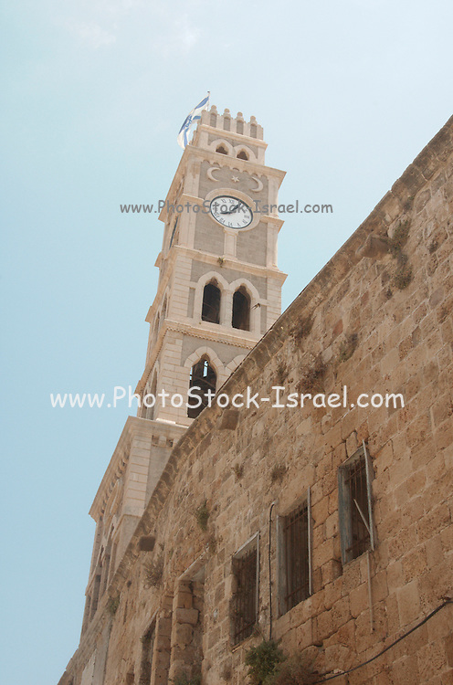 Israel, Acre, The clock tower and walls of the old hostel Khan el Omdan as seen from outside the courtyard, June 2006