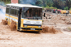 Bus crossing river during flood at Ait Snan on road to Todra Gorge, Morocco