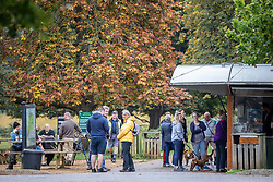 Licensed to London News Pictures. 08/10/2021. London, UK. Members of the public queue up for a coffee as they enjoy the mild temperatures of 15c, (8c warmer than usual) this morning in Richmond Park, south-west London as weather experts reveal that today could be the UK's warmest October morning on record. Temperatures are also predicted to rise this afternoon with highs of 21c expected. Photo credit: Alex Lentati/LNP