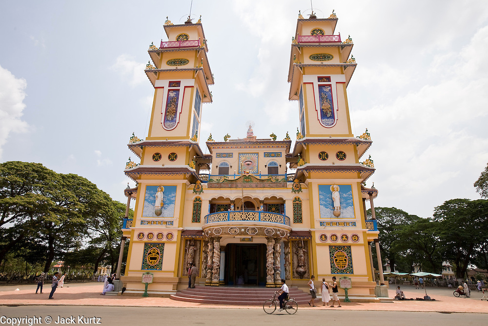 """10 MARCH 2006 - TAY NINH, VIETNAM: The main Cao Dai temple in Tay Ninh. The Cao Dai complex in Tay Ninh is the sect's headquarters. The Cao Dai religion is a blending of Buddhism, Confucianism, Taoism, Christianity and Islam. There """"saints""""  include Chinese leader Sun Yat Sen and French author Victor Hugo. There are about two million members of the Cao Dai religion in Vietnam. British author Graham Greene, who wrote about the Cao Dai in the """"The Quiet American"""" said the relegion was """"a Walt Disney fantasia of the East."""" Photo by Jack Kurtz / ZUMA Press"""