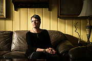 """PENSACOLA, FL – FEBRUARY 19, 2018: Betsy LeGallais, 54, sits in the living room of her Pensacola home. LeGallais estimates she and her mother have spent $120,000 over the years on addiction treatment for her now 25-year-old daughter, Anna Lewis, who first encountered opiates through prescription drugs during high school. Her daughter's opioid addiction quickly led to heroine use, then alcohol, and a few months ago co-payments for Ms. Lewis's latest round of detox took what little savings Ms. LeGallais had begun to build back up again. Despite the financial hardship, LeGallais is still hopeful. """"Anna sought help on her own,"""" she said, """"so I fully support her in her journey to sobriety. It's nothing to be ashamed of anymore. This is a true disease."""" <br /> <br /> The addiction crisis that is killing tens of thousands of Americans every year is also creating a financial crisis for many families, compounding the anguish caused by a loved one''s destructive illness. Families are burning through savings and amassing huge debt paying for rehab that often doesn't work. According to the Substance Abuse and Mental Health Services Administration, federal data show that 22.5% of admissions for substance-abuse treatment involve someone who's already had one previous round of treatment, and another 21% involve people who ha've had two or three previous rounds. The predicament reflects both the difficulty of treating addiction, and the haphazard rehabilitation and insurance system many patients face. <br /> CREDIT: Bob Miller for The Wall Street Journal"""