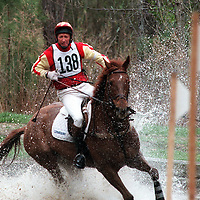 Bruce Davidson rides his horse Squire's Cap through the water obstacle Saturday afternoon at the Southern Pines Horse Trials in Southern Pines. Davidson was riding on the Cross Country Course.