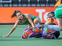 AMSTELVEEN -  Anna O'Flanagan (Ier) met keeper Sofia Monserrat (It)  tijdens de dames -wedstrijd  ,  Ierland-Italie (3-0) bij het  EK hockey , Eurohockey 2021. COPYRIGHT KOEN SUYK