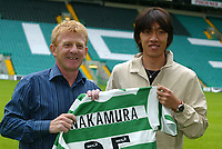 Shunsuke Nakamura parades at Celtic  park today with his new strip and number 25 after signing for Celtic, with his manager Gordon Strachan<br /> <br /> Pic ian Stewart, Friday 29th July 2005