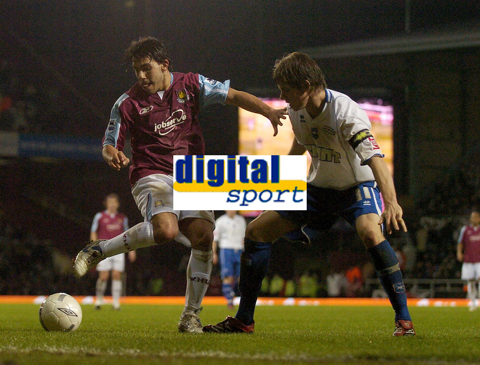 Photo: Olly Greenwood.<br />West Ham United v Brighton & Hove Albion. The FA Cup. 06/01/2007. West Ham's Carlos Tevez and Brighton's Dean Hammond