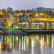This is a beautiful view from Nidelva the river of Trondheim which acts a a naturak mirror. In this picture you can see the beautiful Nidelven terrase and NTNU university main building called Hovedbygningen.