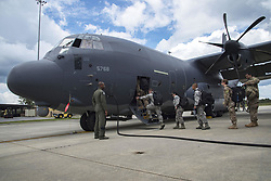 August 26, 2017 - Moody Air Force Base, Georgia, United States - U.S. Air Force crew chief and loadmaster from the 71st Rescue squadron organize bags before securing them on a HC-130J Combat King II traveling to Texas in preparation of possible hurricane relief support Augustust 26, 2017, at Moody Air Force Base, Ga. The 23d Wing launched HC-130J Combat King IIs, HH-60G Pavehawks, aircrew and other support personnel to preposition aircraft and airmen, if tasked to support Hurricane Harvey relief operations. (Credit Image: ? Eric Summers/DOD via ZUMA Wire/ZUMAPRESS.com)