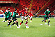 Charlton's Chuks Aneke shoots to score his first goal during the EFL Sky Bet League 1 match between Charlton Athletic and Rochdale at The Valley, London, England on 12 January 2021.