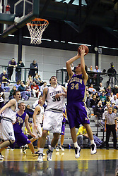 30 December 2006: Aras Butkunas pulls up center lane for a jump shot. The Titans outscored the Britons by a score of 94-80. The Britons of Albion College visited the Illinois Wesleyan Titans at the Shirk Center in Bloomington Illinois.<br />