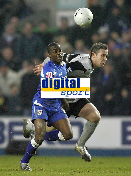 Photo: Lee Earle.<br /> Millwall v Everton. The FA Cup. 07/01/2006. Millwall's Marvin Williams (L) battles with David Weir.