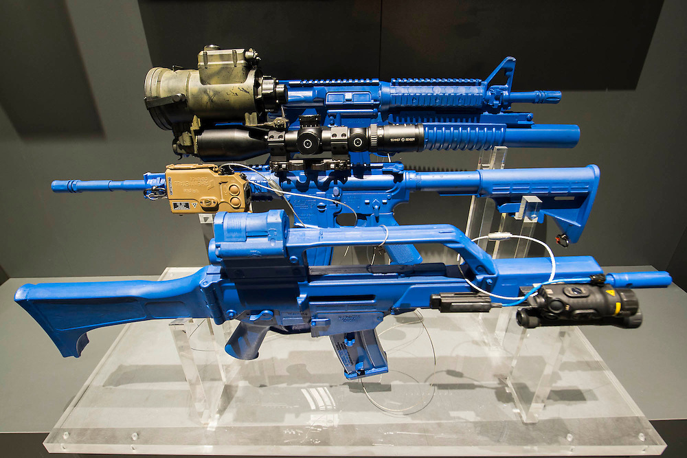 The Rheinmetall stand includes dummy weapons in blue to highlight their sighting accessories - The DSEI (Defence and Security Equipment International) exhibition at the Excel Centre, Docklands, London UK 15 Sept 2015