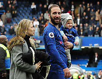 Football - 2018 / 2019 Premier League - Chelsea vs. Watford<br /> <br /> Gonzalo Higuain of Chelsea walks around the pitch with his wife and child after the final home match, at Stamford Bridge.<br /> <br /> COLORSPORT/ANDREW COWIE