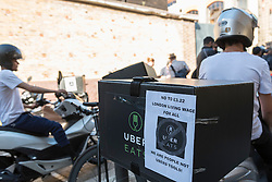 © Licensed to London News Pictures. 26/08/2016. London, UK.  Uber Eats delivery drivers protest and strike at low pay and conditions, outside the Uber Eats headquarters in Bermondsey Street. Photo credit : Stephen Chung/LNP
