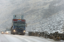 © Licensed to London News Pictures. 29/01/2019. Snowdonia, Gwynedd, Wales, UK. Traffic climbs up Llanberis Pass as heavy snow hits Snowdonia National Park, Gwynedd, Wales, UK. credit: Graham M. Lawrence/LNP