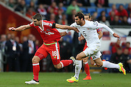 Sam Vokes of Wales has his shirt pulled by Solomon Kverkvelia of Georgia.  Wales v Georgia , FIFA World Cup qualifier, European group D match at the Cardiff city Stadium in Cardiff on Sunday 9th October 2016. pic by Andrew Orchard, Andrew Orchard sports photography