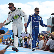 Race car drivers Matt DiBenedetto (L) and Ricky Stenhouse Jr. are seen during driver introductions prior to the 58th Annual NASCAR Daytona 500 auto race at Daytona International Speedway on Sunday, February 21, 2016 in Daytona Beach, Florida.  (Alex Menendez via AP)
