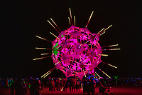 RadiaLumia by: FoldHaus Collective from: Oakland, CA year: 2018<br /> <br /> RadiaLumia is a geodesic sphere, five-stories tall, and covered with a breathing skin of origami shells and radiant spikes. Its shape nods to radiolaria, a tiny protozoa with intricate mineral skeletons that covered the desert thousands of years ago, when it was once the sea floor. From the outside, you can see the folds of the shells, made of corrugated polypropylene and illuminated with over 100,000 LEDs. Inside the sphere, a platform offers a place for people to retreat and look out to the surrounding landscape. The shells open and close in response to visitors' presence, constantly in motion, sometimes protecting the intimate interior of the sphere, sometimes revealing a glimpse of its heart. URL: http://www.foldhaus.com