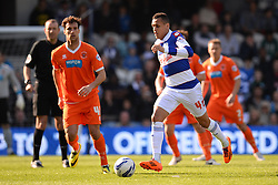 Blackpool's forward Apostolos Vellios and QPR's midfielder Ravel Morrison  - Photo mandatory by-line: Mitchell Gunn/JMP - Tel: Mobile: 07966 386802 29/03/2014 - SPORT - FOOTBALL - Loftus Road - London - Queens Park Rangers v Blackpool - Championship