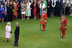 RETRANSMITTED CORRECTING BYLINE Queen Elizabeth II arrives for a Royal Garden Party at Buckingham Palace in London.