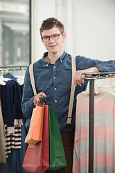 Portrait of  young man at fashion store