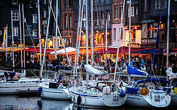 Yachts tied up in the harbour in the evening in Honfleur, Normandy, France