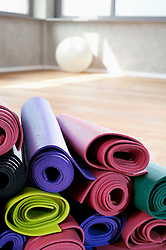 Close up Pile of colorful Yoga mats