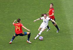 USA's Rose Lavelle  (centre) in action against Spain's Virginia Torrecilla (left) and Patricia Guijarro