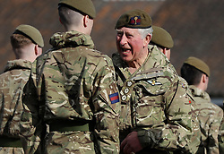 The Prince of Wales, Colonel Welsh Guards, presents campaign medals to soldiers from the 1st Battalion Welsh Guards at Elizabeth Barracks, Pirbright Camp in Woking, following their return from Afghanistan.