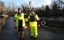 ©London News pictures... 17/11/2010. Police close 'The Old Bridge' . The River Fowey burst its banks at Lost Withiel in Cornwall. today (Wednesday). Some people have been left trapped in their cars and homes in parts of Cornwall as heavy rain and gale-force winds caused flooding and disruption.