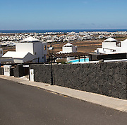 View over new villa developments at Playa Blanca, Lanzarote, Canary Islands, Spain