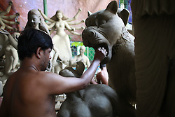 September 23, 2016 - Dhaka, Bangladesh - A Bangladeshi artist works on a clay idol of the Hindu Goddess Durga in preparation for the upcoming Hindu religious festival Durga Puja in Old, Bangladesh, September 23, 2016. Durga Puja or Sharadotsav is an annual Hindu festival in South Asia that celebrates worship of the Hindu goddess Durga. The annual five-day Hindu festival worships the goddess Durga, who symbolizes power and the triumph of good over evil in Hindu mythology. (Credit Image: © Suvra Kanti Das via ZUMA Wire)