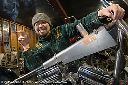 Custom Works Zon's Yuichi Yoshizawa with a new custom project in his shop in Shiga Prefecture, Japan. December 8, 2015.  Photography ©2015 Michael Lichter.