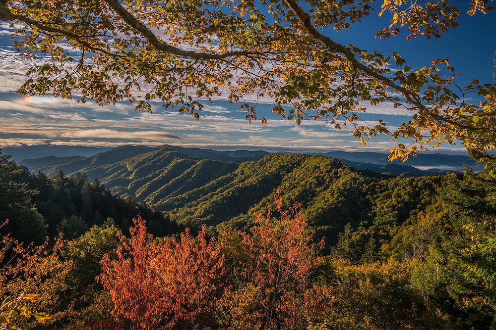 Newfound Gap framed by fall color, last light and shadows highlight ridgeline patterns across the mountain range, Great Smoky Mtns National Park, Gatlinburg, TN
