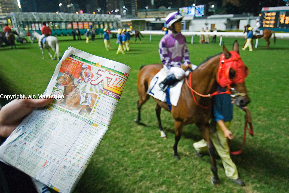 Horse racing at famous Happy Valley racecourse in Hong Kong